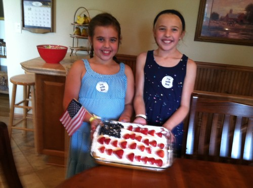 Olivia and Addie spotlighting their baking project from the day before