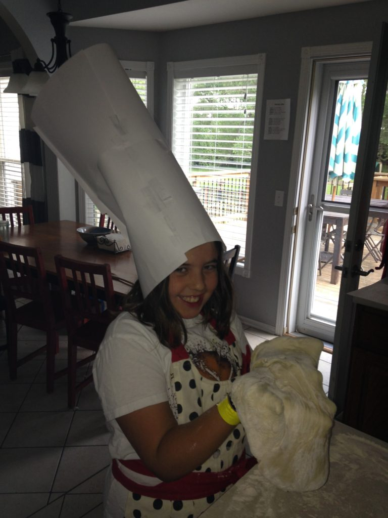 Addison wearing her chef's hat