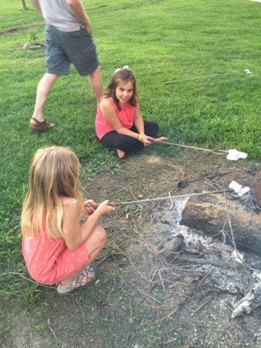 Addie and Ava roasting marshmallows