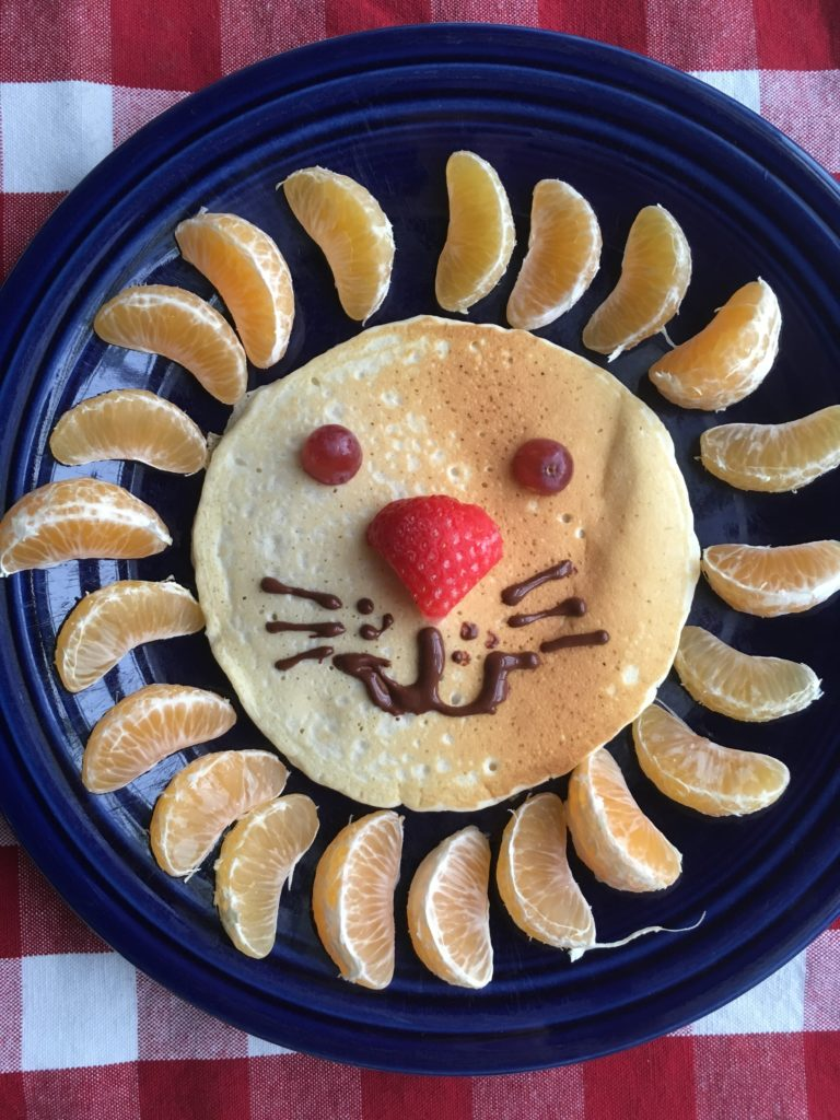 Lion pancakes for kids the gingham apron we started with a boxed pancake mix if youre craving homemade pancakes check out these banana pancakesyum eyes halved grapes nose a halved ccuart Gallery